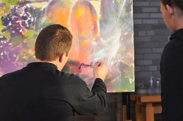 Signing the painting which will hang somewhere at Trinity Lutheran Church