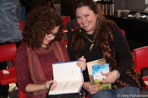 Sheila O'Connor signing a book for Mary Aalgaard