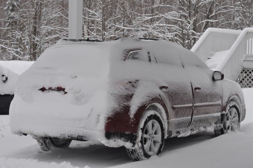 Scarlet wrapped in her chilly blanket of snow, parked safely at our destination.