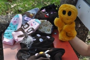 Mr. Happy and all his puppet pals, chillin' at the park.