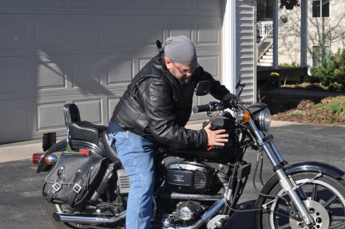 The Biker Chef, caressing his 1981 Sturgis, shovel.