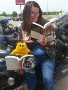 Mr. Happy and Mary reading a couple books in the Liv Bergen mystery series by Sandra Brannan.