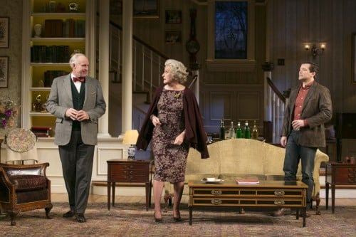 Peter Thomson (Bradley), Kandis Chappell (Ann) and Rod Brogan (John) in the Guthrie Theater's production of The Cocktail Hour, by A.R. Gurney, directed by Maria Aitken with set design by James Youmans, costume design by Robert Morgan and lighting design by Philip S. Rosenberg. November 22, 2014 - January 4, 2015 on the McGuire Proscenium Stage at the Guthrie Theater, Minneapolis. Photo by Heidi Bohnenkamp.