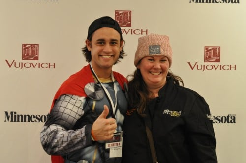 Mary Aalgaard wearing her Love Your Melon hat with a super hero who volunteers to help kids!
