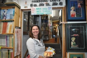 Mary Aalgaard on a book treasure hunt in Lincoln City, OR, used bookstore.
