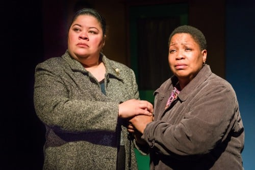 Mary (Thomasina Petrus) and Noel's mother (Aimee K. Bryant) united in pain and fear for the future, as they hold each other up and believe in a better tomorrow. Photo by Rich Ryan