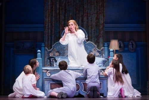 Billie Wildrick (Maria) with the von Trapp children. Photo by Rich Ryan Photography