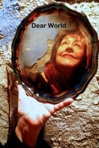 Countess Aurelia, played by Janet Paone, gazing into the mirror, reflecting on both the past and future, in Dear World, presented by Ten Thousand Things Theater Company