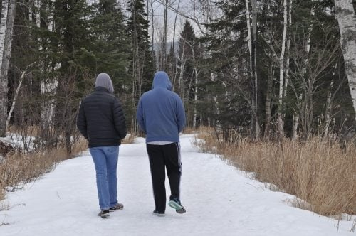 Charlie and Eric heading down the icy trail. Eric loaned me his warm cap. Nice boy, taking care of his mother.