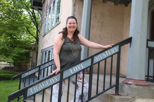 I asked Tracy Blowers, fellow theater blogger and professional photographer, to snap a couple pics of me at the Playwrights' Center. They have words all along their railings. Here I am looking excited to attend the reading of Lee Blessings' newest play.