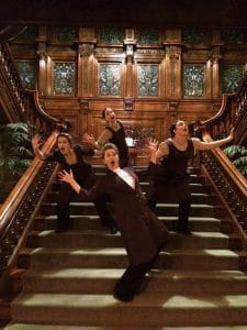 Maids on the staircase. Tartuffe at the James J. Hill House, photo by Gillian Randall