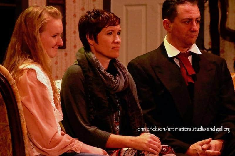 Jaden Wendt as young Beth, Jenn Abramson as Marmee, and Kevin Yeager as Father March in Stage North's 2016 Holiday production of Little Women. Photo by John Erickson