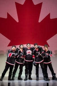 Canadian 'youth' hockey players in The Abominables at Children's Theatre Company, photo by Dan Norman