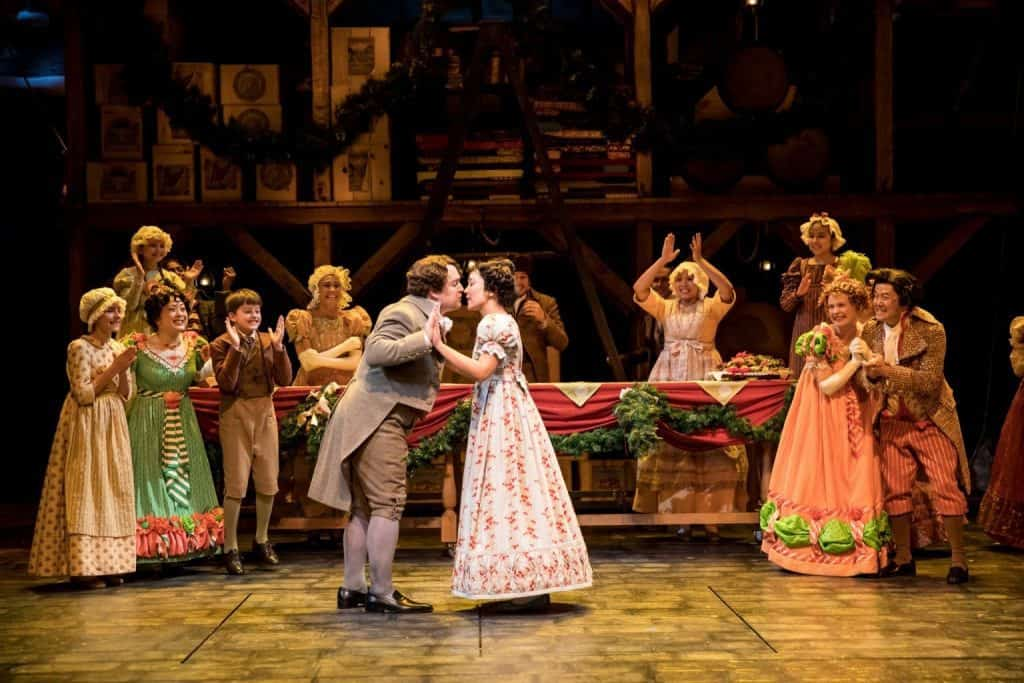 The cast of the Guthrie Theater's production of A Christmas Carol by Charles Dickens, adapted by Crispin Whittell, directed by Lauren Keating. Scenic design by Walt Spangler, costume design by Mathew J. LeFebvre, lighting design by Christopher Akerlind. November 14 – December 30, 2017 on the Wurtele Thrust Stage at the Guthrie Theater, Minneapolis. Photo by Dan Norman.