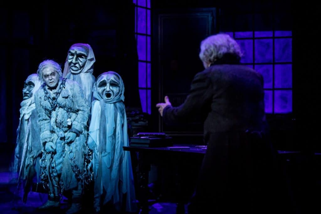 John Catron (Jacob Marley) and Nathaniel Fuller (Ebenezer Scrooge) in the Guthrie Theater's production of A Christmas Carol by Charles Dickens, adapted by Crispin Whittell, directed by Lauren Keating. Scenic design by Walt Spangler, costume design by Mathew J. LeFebvre, lighting design by Christopher Akerlind. November 14 – December 30, 2017 on the Wurtele Thrust Stage at the Guthrie Theater, Minneapolis. Photo by Dan Norman.