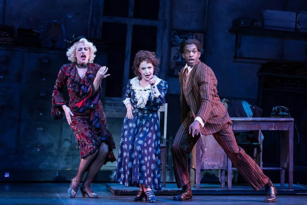 Cat Brindisi as Lily, Michele Ragusa as Miss Hannigan, and Britton Smith as Rooster in the Ordway's production of Annie, playing through Dec. 31, 2017. Photo by Rich Ryan.