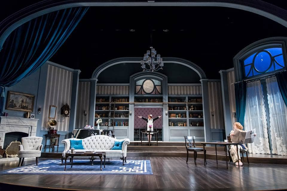 Suzanne Warmanen (Edith) and Heidi Armbruster (Ruth) in the Guthrie Theater's production of Blithe Spirit by Noël Coward, directed by David Ivers. Scenic design by Jo Winiarski, costume design by Meg Neville, lighting design by Xavier Pierce, sound design by Scott W. Edwards. Photo by Dan Norman.