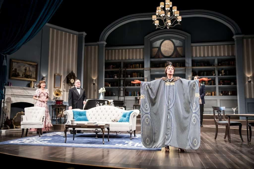 Amy Warner (Mrs. Bradman), Bob Davis (Dr. Bradman) and Sally Wingert (Madame Arcati) in the Guthrie Theater's production of Blithe Spirit by Noël Coward, directed by David Ivers. Scenic design by Jo Winiarski, costume design by Meg Neville, lighting design by Xavier Pierce, sound design by Scott W. Edwards. Photo by Dan Norman.
