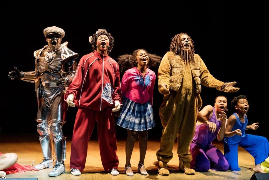 R. Michael Rambo as the Tinman, Dwight Leslie as Scarecrow, Paris Bennett as Dorothy, Rudolph Searles III as the Cowardly Lion, and ensemble dancers in The Wiz. Photo by Dan Norman
