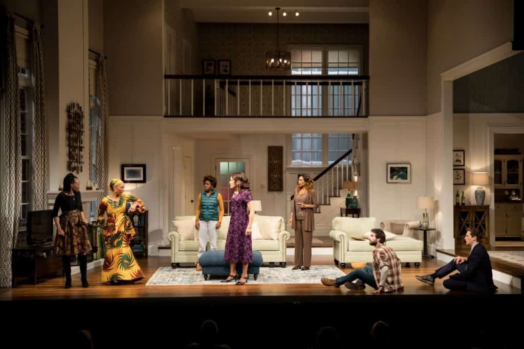 The cast of the Guthrie Theater's production of Familar by Danai Gurira, directed by Taibi Magar. Scenic design by Adam Rigg, costume design by Karen Perry, lighting and projection design by Tom Mays and sound design by Scott W. Edwards. March 10 – April 14, 2018 on the McGuire Proscenium Stage at the Guthrie Theater, Minneapolis. Photo by Dan Norman.