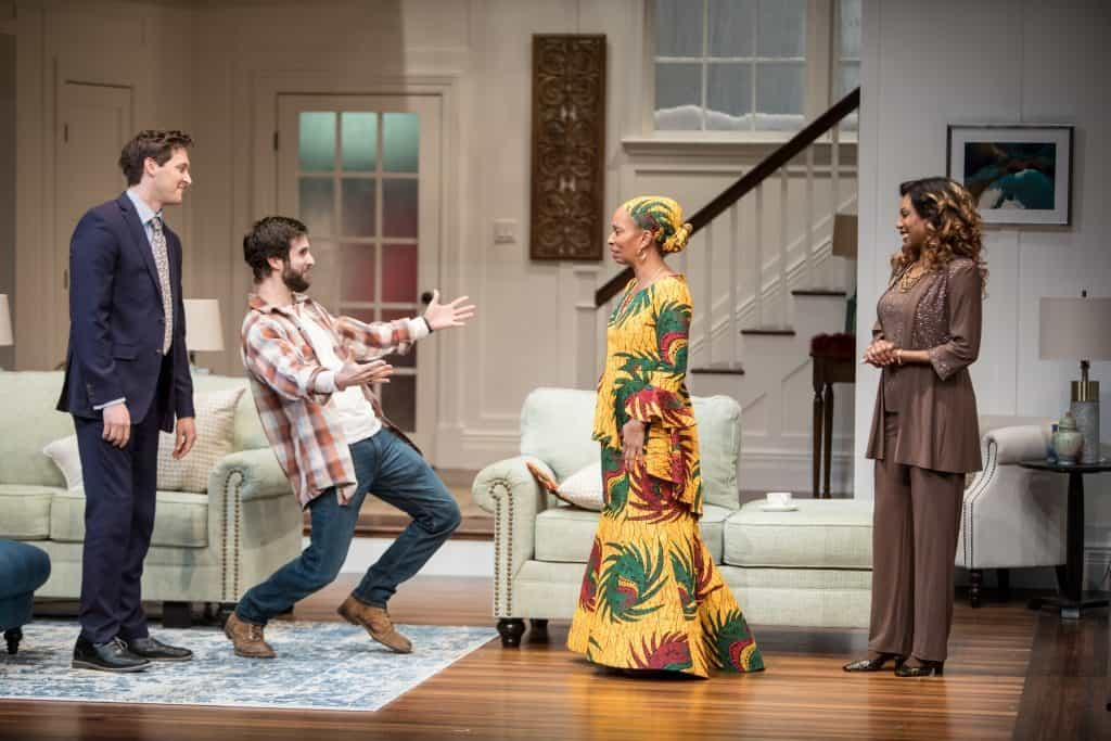 Quinn Franzen (Chris), Michael Wieser (Brad), Wandachristine (Anne Mwarimba) and Austene Van (Prof. Margaret Munyewa) in the Guthrie Theater's production of Familar by Danai Gurira, directed by Taibi Magar. Scenic design by Adam Rigg, costume design by Karen Perry, lighting and projection design by Tom Mays and sound design by Scott W. Edwards. March 10 – April 14, 2018 on the McGuire Proscenium Stage at the Guthrie Theater, Minneapolis. Photo by Dan Norman.