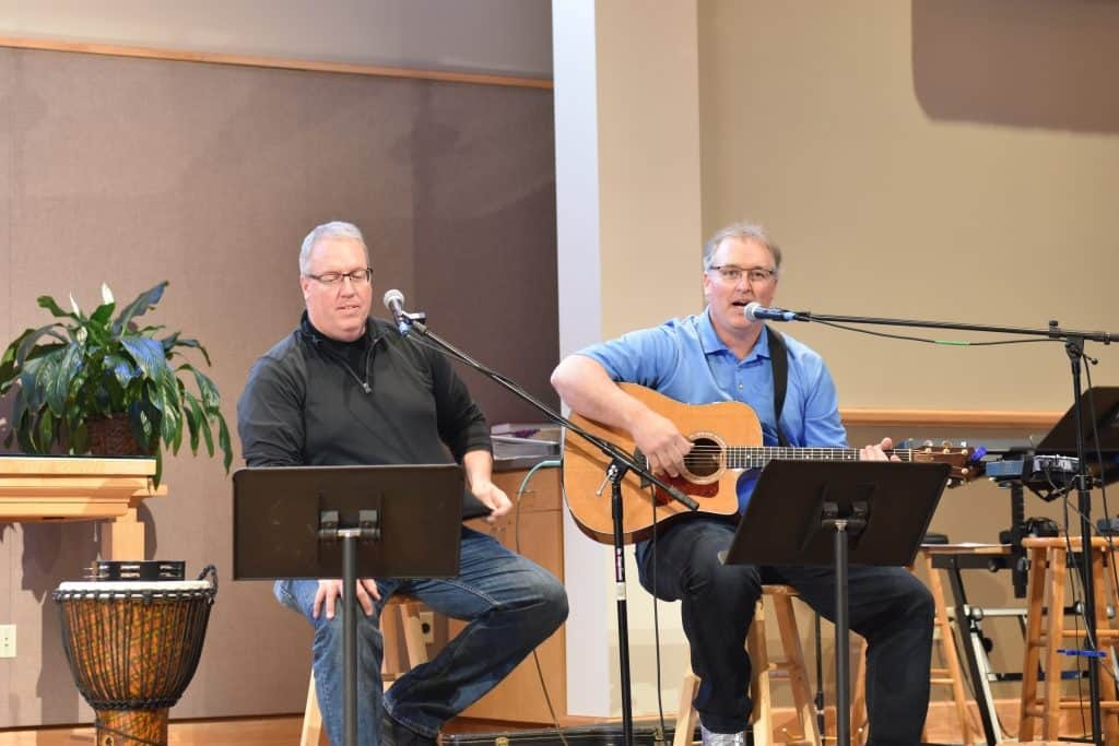A drummer and guitar player singing at Lord of Life Church in Baxter, MN