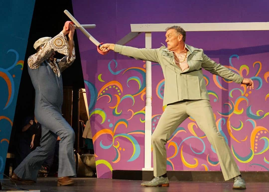 Edmond Binda as Sebastian and Mark Liedl and Curio in Stage North's production of Twelfth Night. Production photo.