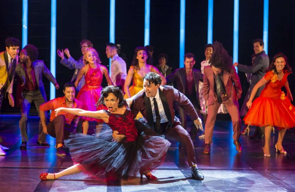 Ana Isabelle (Anita), Marco Antonio Santiago (Bernardo) and the cast of the Guthrie Theater's production of West Side Story, based on a conception of Jerome Robbins with a book by Arthur Laurents. Music by Leonard Bernstein, lyrics by Stephen Sondheim, directed by Joseph Haj. Scenic design by Christopher Acebo, costume design by Jen Caprio, lighting design by Bradley King, sound design by Elisheba Ittoop. June 16 – August 26, 2018 on the Wurtele Thrust Stage at the Guthrie Theater, Minneapolis. Photo by T Charles Erickson.