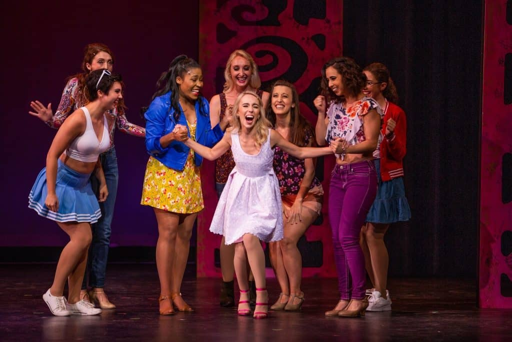 Angela Steele (center) with Caitlin Featherstone, Mari Holst, Brittany Marie Wilson, Dorian Brooke, Sarah DeYong, Antonia Perez, and Abigail Rose Sharp. In Legally Blonde at Artistry. Photos by Devon Cox