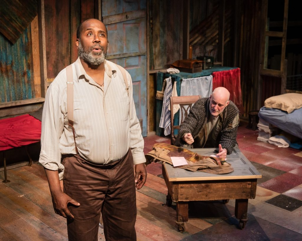 James A. Williams as Zachariah and Stephen Yoakam as Morris in Blood Knot at Pillsbury House Theatre. Morris is helping his brother write a letter to a woman from the Personal ads. Photo by Rich Ryan